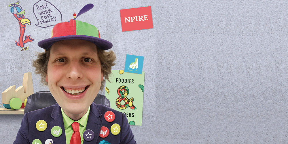 A guy with a jacket full of badges and a funny hat